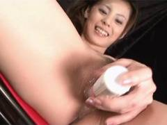 Sexy Natsumi bangs a vibrator around her snatch